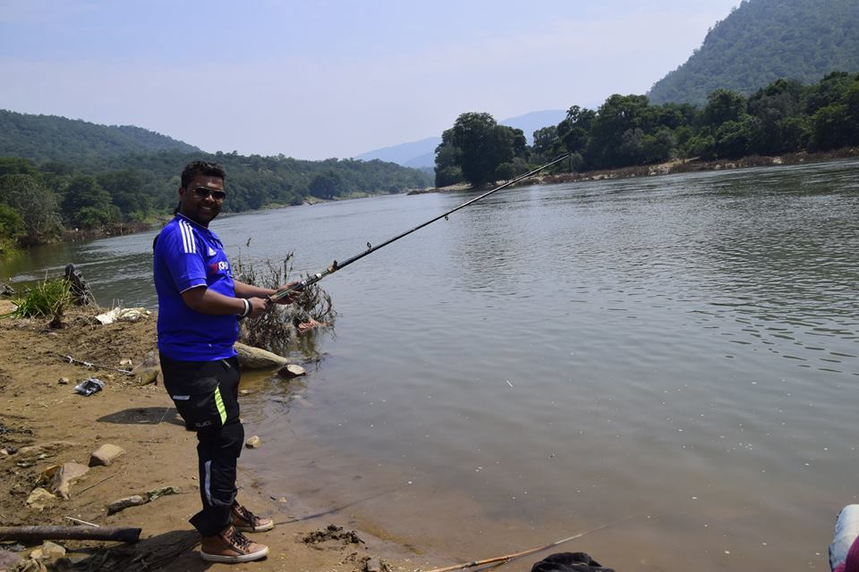 with Fishing Rod for a pose